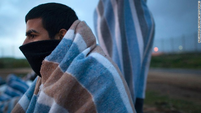 A Syrian refugee is seen in the early morning hours after sleeping outside the Center for Temporary Stay of Immigrants on Wednesday, April 2, in Melilla, Spain. The number of Syrians who have fled their war-ravaged country is more than 2 million, according to the United Nations.