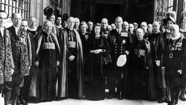 The Queen, then as Princess Elizabeth, poses for a group photo with her entourage, Vatican knights and Swiss Guards following a talk with Pope Pius XII in April 1951.
