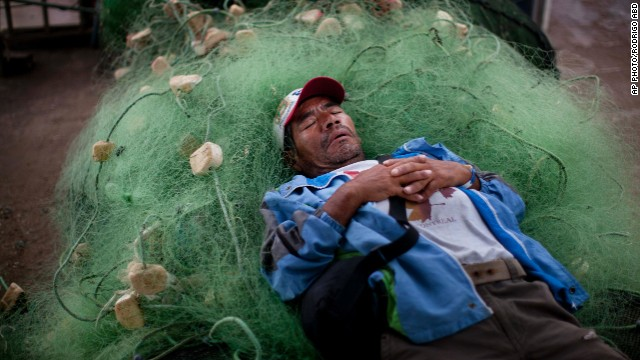 APRIL 3 - LIMA, PERU: A fisherman naps on a bunch of fishing nets near the mining port of Iquique. Chilean authorities said there was surprisingly light damage after a magnitude 8.2 quake struck and a tsunami warning was issued in the Pacific Ocean.