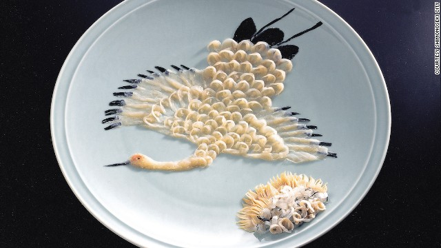 """Fugu is served in transparent paper-thin strips on painted porcelain plates,"" says Toshiharu Hata, who runs the largest fugu wholesale business in Shimonoseki, Japan. ""Master chefs cut them into chrysanthemum petals, Mount Fuji or animals like peacocks, turtles and butterflies."""