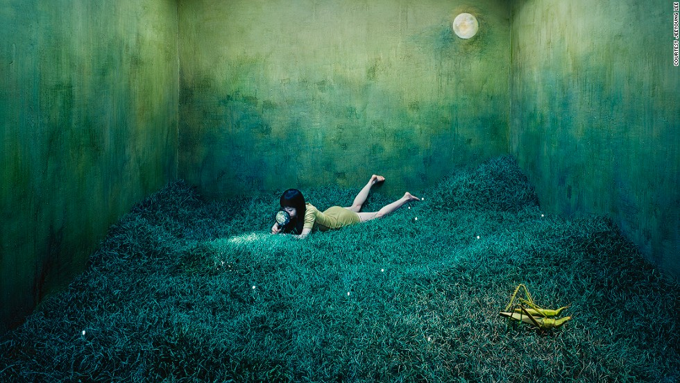"Korean artist JeeYoung Lee creates worlds of surreal beauty and mystery in her tiny 3 meter x 6 meter studio in the Mangwon-dong neighborhood of Seoul. The 30-year-old documents her dreams, memories, and emotions by building thematic sets, and photographing herself as a character in their narrative. The otherworldly images, which were recently exhibited at the <a href='http://www.opiomgallery.com/fr/artistes/oeuvresphotographe/17/jeeyoung-lee' target='_blank'>Opiom Gallery</a> in France, portray a tangible representation of the artist's imagination, and make it hard to believe that she builds the scenery herself, and doesn't use Photoshop.<!-- --> </br><!-- --> </br><i>Treasure hunt</i><!-- --> </br><!-- --> </br>It took Lee three months to create this magical nocturnal landscape. The grass is made of craft wire, and every single piece is connected to a mesh screen. The artist was inspired by childhood memories of holidays spent at her grandparents' farm in the countryside, where after nightfall she would see scores of fireflies lit up against the dark shrubbery: ""To me they looked like they were on a treasure hunt,"" she explains, ""and I used that as a metaphor to show that finding your ideal is as difficult as searching for a needle in a grassy field."" The scene is set at night to emphasize the difficulty of the task.<!-- --> </br><!-- --> </br><i>Interview by </i><strong><i><a href='https://twitter.com/M_Veselinovic' target='_blank'>Milena Veselinovic </a></i></strong>"