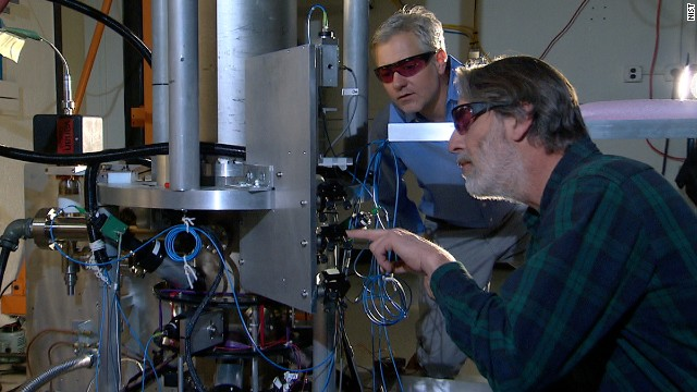 Physicists Steve Jefferts, front, and Tom Heavner work on the NIST-F2 atomic clock, a new time standard in the United States.