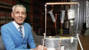 Jack Kevorkian poses with his Thanatron suicide machine\