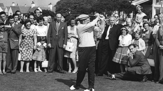 U.S. President Dwight D. Eisenhower drives down the fairway at Turnberry in Scotland in 1959. Eisenhower, a friend of Palmer's, was a golfing fanatic who <a href='http://www.whitehousemuseum.org/west-wing/oval-office-history.htm' target='_blank'>destroyed the floor of the White House's Oval Office</a> with his golf spikes.