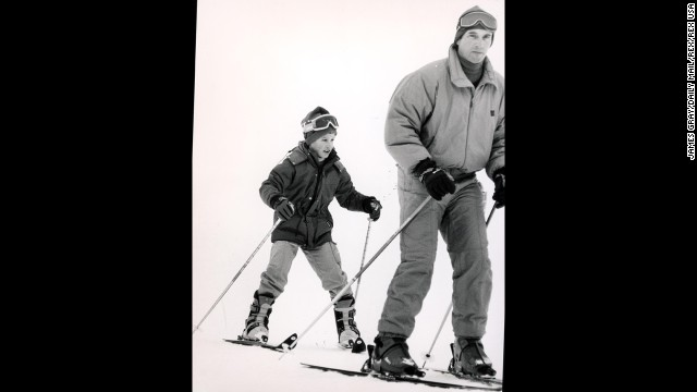 Capt. Mark Phillips, then-husband of Princess Anne, skies with his son, Peter, in Morzine, France, in January 1986.