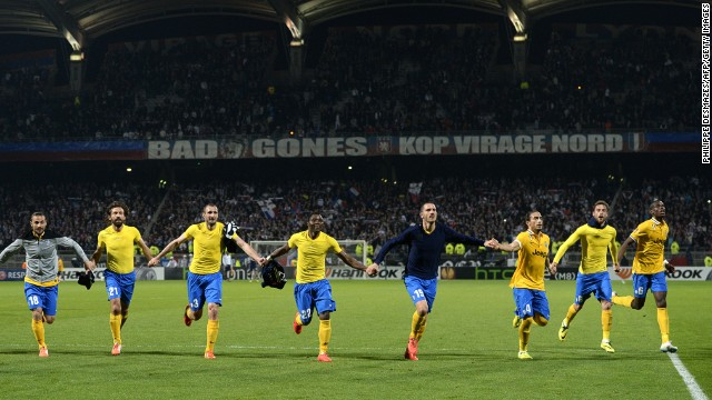 Juventus players celebrate a 1-0 win over Lyon in their Europa League quarterfinal first leg tie.