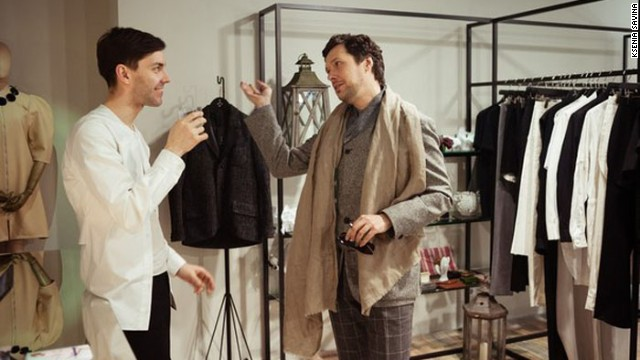Leonid Alexeev (left) is one of St. Petersburg's leading designers. The man on the right holds an invisible tray of drinks.