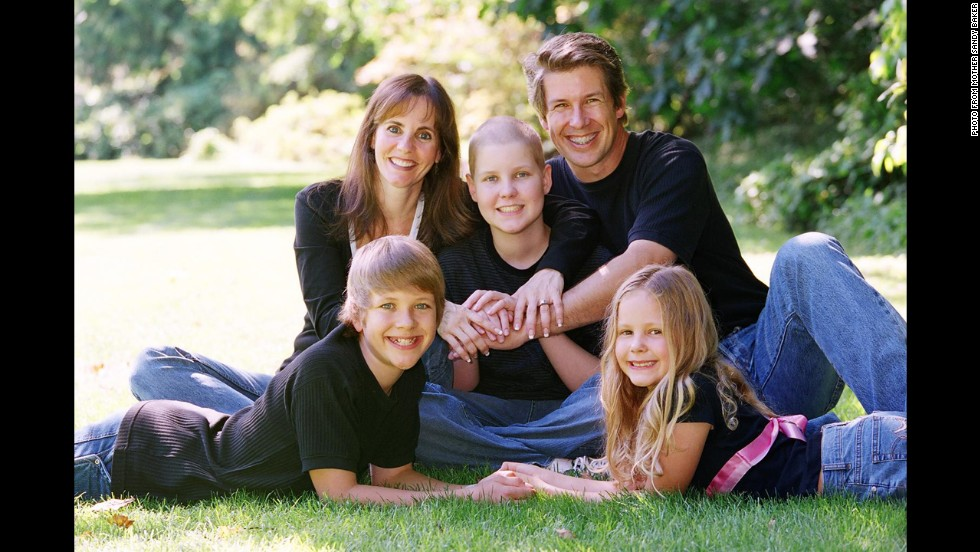 """When leukemia patient Christian Barker, center, received a bone marrow transplant, the donor cells attacked his body. By the time he was given permission to use an experimental drug, it was too late, his mother says. Christian died at age 14. """"What haunts me is how my child suffered so much,"""" says Sandy Barker."""