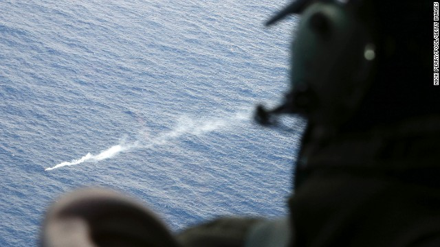 A member of the Royal New Zealand Air Force looks at a flare in the Indian Ocean during search operations on Friday, April 4.