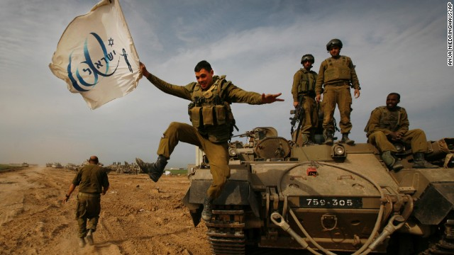She was the only woman on a team of 11 Associated Press photographers that won the 2005 Pulitzer Prize for for their coverage of the Iraq War. In this photo from 2009, Niedringhaus captures an Israeli soldier jumping off an armored vehicle, while carrying a flag of the country's 60th anniversary.