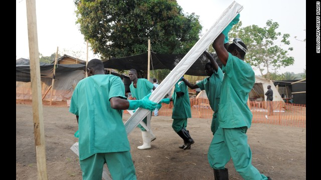 Health specialists work March 31 at an isolation ward for patients at the facility in southern Guinea.