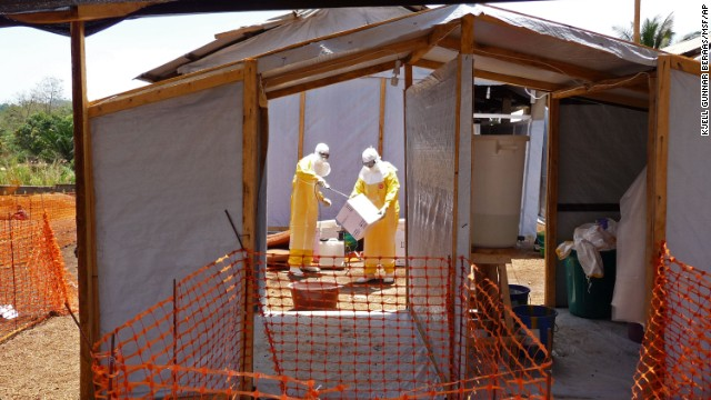 Workers associated with Doctors Without Borders prepare isolation and treatment areas Friday, March 28, in Guinea.