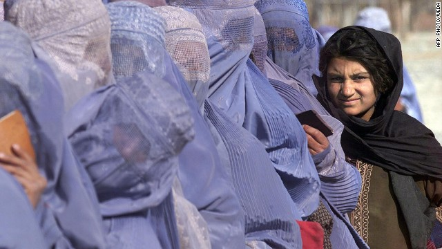"Women wait to receive food aid during a U.N. World Food Program scheme in Kabul in December 2001. ""Even inside Afghanistan, female dress code varies hugely between regions,"" says Mosadiq. ""You'll find the blue burqas across the whole country, but in urban centers like Kabul many women will only wear a hijab. In the north a white burqa is common, and in some Pashtun areas you'll find women in colorful dresses and just a headscarf."""