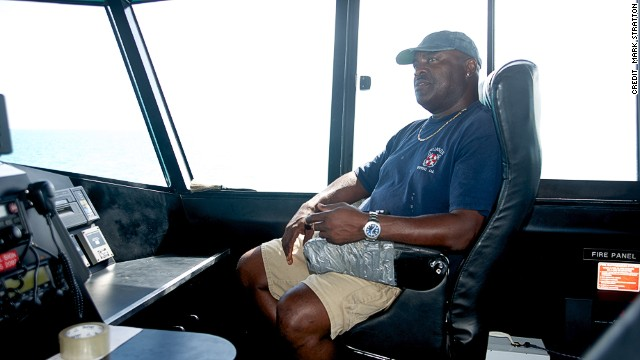 "Captain Jed Munroe at the helm of ""Island Link"" heading to Long Island. ""We carry everything and anything,"" says Munroe."