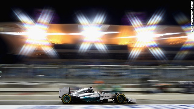 Lewis Hamilton continued his fast start to the 2014 F1 season finishing quickest under the lights in Friday's practice in Bahrain.