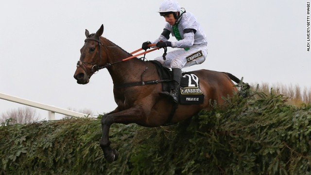 Pineau De Re clears the last fence on the way to victory in the Grand National steeplechase at Aintree Racecourse.