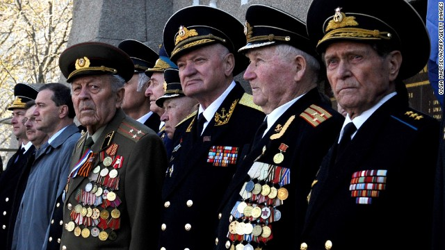Soviet military veterans take part in a flower-laying ceremony at the Soviet-era World War II memorial in Sevastopol on Thursday, April 3.