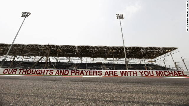 The Bahrain International Circuit also had a sign in honor of the seven-time world champion, who on the Friday before the race was said to be showing signs of awakening from the three-month coma he has been in after a skiing accident.