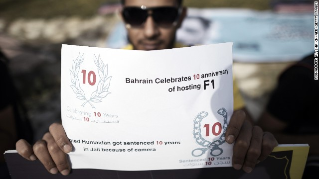 A Bahraini photographer holds a placard to express solidarity with jailed colleague Ahmed Humaidan during the protest at Shakhurah.