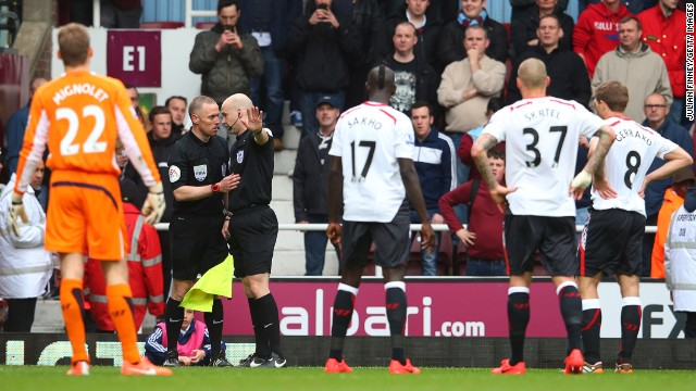 However, referee Anthony Taylor overruled his linesman, allowing the goal by Guy Demel to stand -- while Liverpool's players watched bemused as the big-screen replay showed Mignolet being impeded at the preceding corner.
