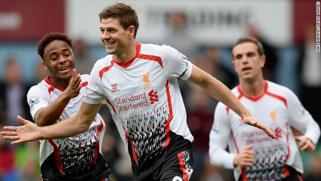 Liverpool captain Steven Gerrard celebrates after scoring the first of his two penalties in the 2-1 win at West Ham, which put his side back at the top of the English Premier League.