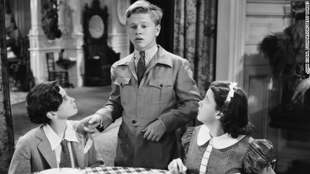 "Mickey Rooney stars with Judy Garland and Ronald Sinclair in a scene from the comedy ""Thoroughbreds Don't Cry."""
