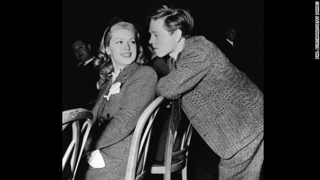 Rooney talks with Lana Turner in the late 1930s.