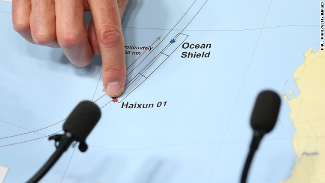 A member of the search operation points to a map outlining search areas during a news conference April 7 in Perth.