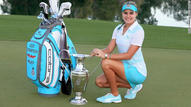 Lexi Thompson poses with the Kraft Nabisco Championship trophy following a three-shot win in California.