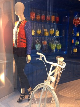 Fay's window display may be a more realistic portrayal of Milanese life than you think. Biking is no excuse to sacrifice style -- especially with a colorful down jacket.