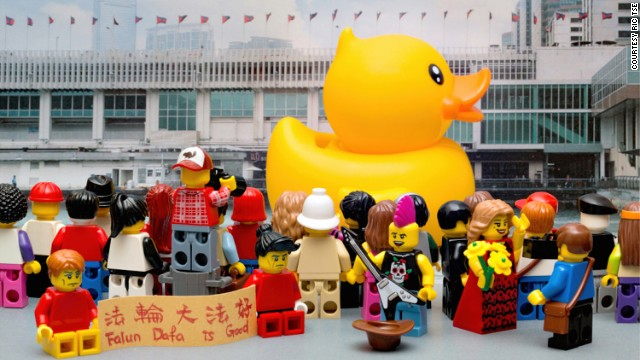 Tse recreated the crowds that flocked to the famed <a href='http://edition.cnn.com/2013/05/02/travel/hong-kong-giant-duck/'>Big Yellow Duck</a> in Hong Kong last year. He even threw in a few of the <a href='http://globalpublicsquare.blogs.cnn.com/2013/07/23/u-s-should-press-china-over-falun-gong/'>Falun Dafa</a> worshippers -- the practice is banned in China -- who often set up small demonstrations in Hong Kong.