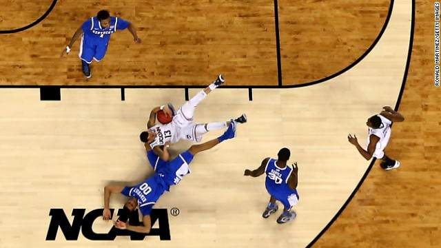 Napier goes to the court as he collides with Lee in the first half.