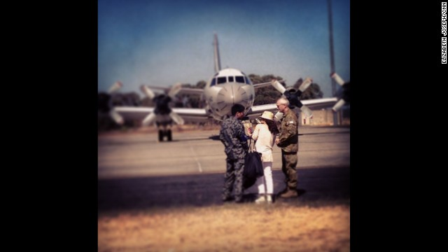 """Don't tell CNN Tokyo's Junko Ogura that she can't walk up to the flight line! She's little but she's scrappy. After sneaking away from the rest of the press, she tried to convince the commander of the Japanese search mission to take her and our camera onto the plane in the background."" By CNN's Elizabeth Joseph at RAAF Base Pearce, April 3. Follow Elizabeth on Instagram at instagram.com/ejo1224."