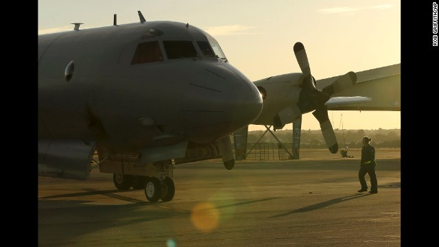 A member of the Royal Australian Air Force walks toward a plane that just arrived in Perth on April 8.