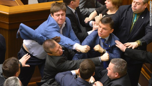 Ukrainian lawmakers from different parties scuffle during a Parliament session in Kiev, Ukraine, on Tuesday, April 8.