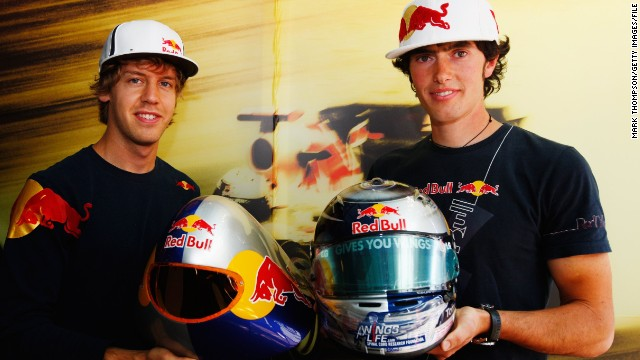 Origone's younger brother Ivan (r) posing alongside Red Bull Formula One world champion Sebastian Vettel in 2009. The 27-year-old is sponsored by the Austrian energy drink brand and is one of the world's finest speed skiers, setting a junior record of 250.7 km/h (155.7 mph) in 2006.