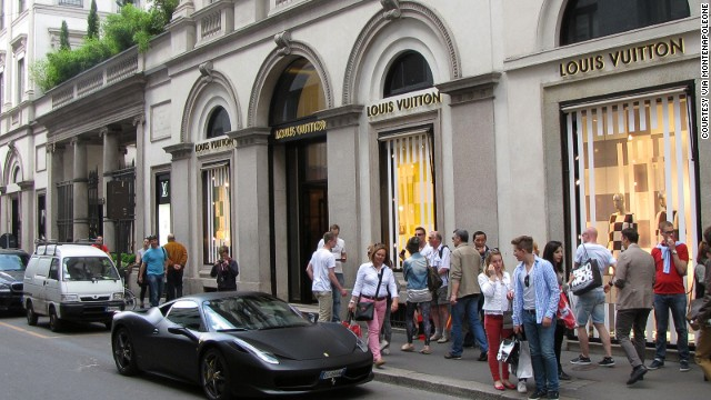 The only thing faster than a Supercar on Milan's Via Montenapoleone? The swiping of credit cards. Fashion's biggest names mix with Ferraris and Lamborghinis to ensure well-heeled shoppers arrive and depart in style. But where to cram those bulky bags?