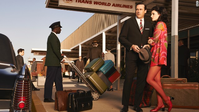 "Don and Megan Draper show up to the airport in fashionably bright colors in this promotional photo for the seventh season. While researching 1960s fashion, Przybyszewski was surprised to find that women's dresses in the late 1960s could be even shorter than Megan's. The money spent on tights and pantyhose worn with these dresses was ""mind boggling,"" she said."