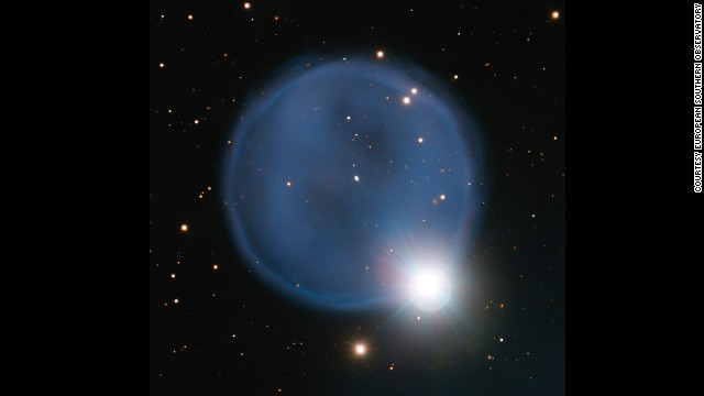 "Planetary nebula Abell 33 appears ring-like in this image, taken using the European Southern Observatory's Very Large Telescope. The blue bubble was created when an aging star shed its outer layers and a star in the foreground happened to align with it to create a ""diamond engagement ring"" effect. Click through to see other wonders of the universe."