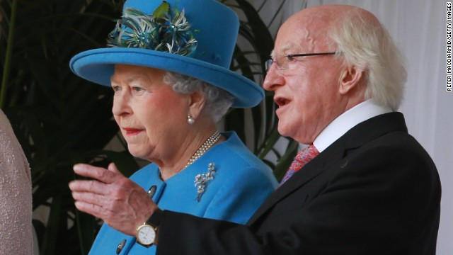 Queen Elizabeth stands with Michael D. Higgins, the President of Ireland, during a ceremonial welcome at Windsor Castle on April 8, 2014. Higgins is the first Irish head of state to make a state visit to the United Kingdom.