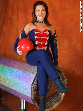 "Two decades later she goes by the stage name ""Shooting Star,"" working alongside her human cannonball husband, Chachi."