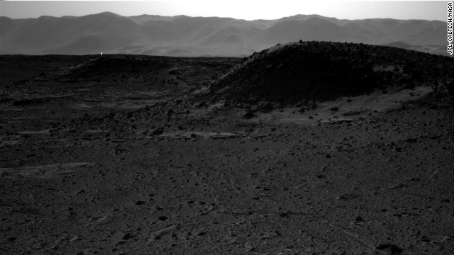 "NASA says the bright spot in this image taken in April on Mars by the Curiosity rover could be merely a ""glinting rock or cosmic-ray hit."" The Curiosity rover set off from Earth in November 2011 and landed some eight and a half months later -- 99 million miles away."