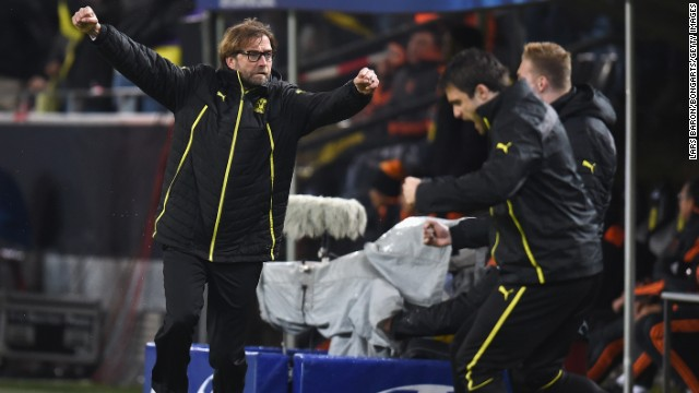 That goal brought Dortmund manager Jurgen Klopp, left, to his feet.