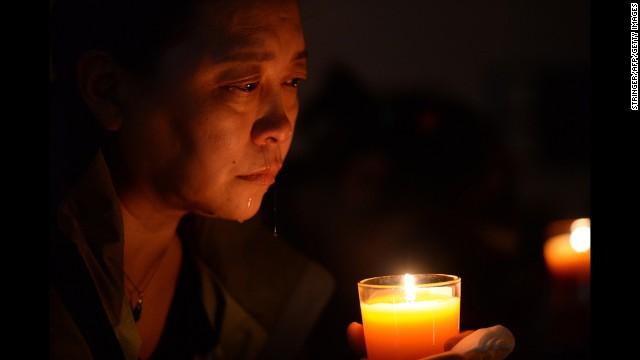 A relative of a missing passenger cries at a vigil in Beijing on Tuesday, April 8.