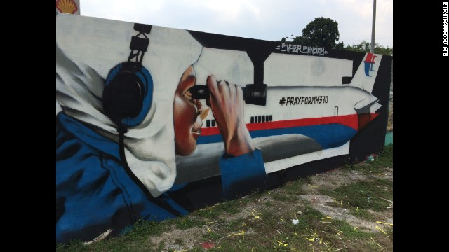 """MH370 wall art in Kuala Lumpur, Malaysia - still hopeful for survivors. Defense Minister Hishammuddin said Monday they cannot rule out that possibility, despite earlier statements indicating that improbable."" By CNN's Nic Robertson, April 8. Follow Nic on Instagram at instagram.com/nicrobertsoncnn."
