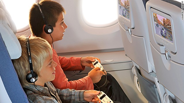 The in-flight entertainment system is your best friend on a flight. Hours of kids' movies, games and TV shows to keep them busy. Pack an extra pair of headphones though. Some airlines only hand out ear bud sets, which aren't built for little heads.