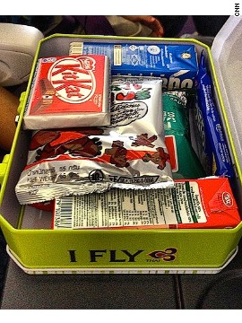 """I Fly"" indeed. Kids will be flying high on a sugar rush after they polish off one of these snack boxes Thai Airways hands out to children on its flights. That said, a bit of junk food will keep your children quiet those first few moments of a flight."