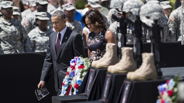 President Barack Obama and first lady Michelle Obama arrive for a memorial service in Fort Hood, Texas, on Wednesday, April 9. Officials say Army Spc. Ivan Lopez took a .45-caliber handgun onto the military post last week, killing three people and injuring 16 before taking his own life.