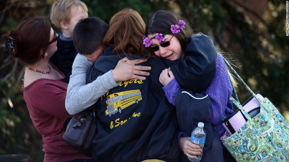 Parents and students embrace near Franklin Regional High School, where authorities say at least 20 people were injured in a stabbing spree Wednesday, April 9, in Murrysville, Pennsylvania.