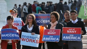 Protesters gather at the U.S. Supreme Court as it hears a case about a university\'s use of race in its admission policy.